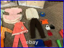 1960's Vintage Barbie doll, case lot of clothes and accessories